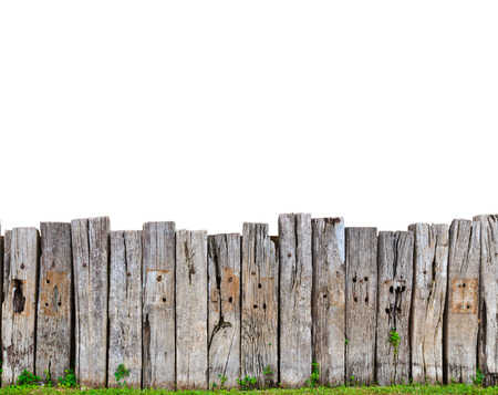 fence post: old wooden fence in garden with plant