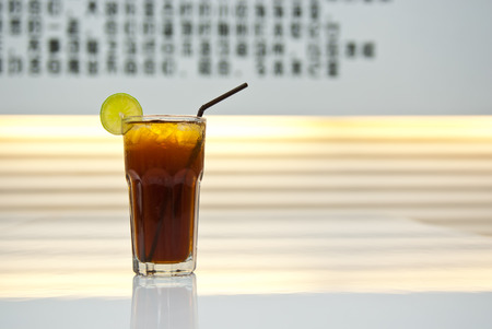 ice lemon tea: drink in a glass on the table