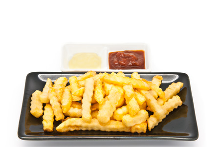 chinese menu: French fries in black plate on white background