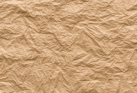 crumpled paper: background and texture of brown crumpled paper