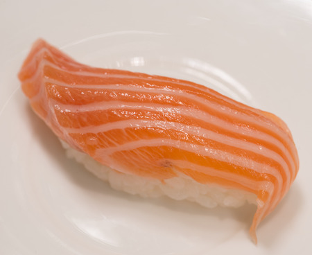 susi: closeup detail japanese classic sushi with fresh salmon fish on white plate background