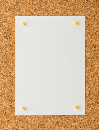 cork sheet: close up Blank white paper note sheet with yellow push pin on cork board background for write memo