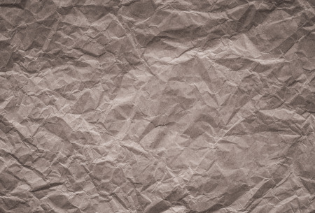 crinkly: background and texture of brown crumpled paper