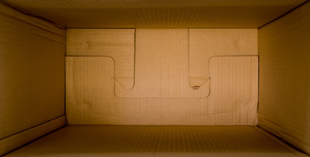 custom cabinet: close up packed or hidden inside a cardboard packaging box Stock Photo