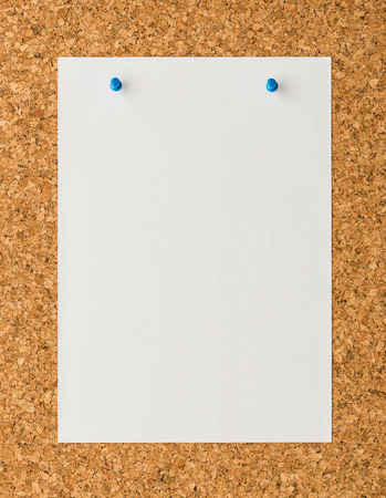 cork sheet: close up Blank white paper note sheet with blue push pin on cork board background for write memo