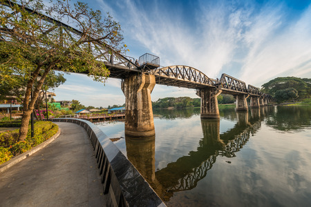 railway history: The death railway bridge is a history of world war ii, the death railway bridge over Kwai river built by Japanese soldiers at sunrise time, Kanchanaburi, Thailand