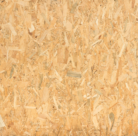 osb: close up pressed wooden panel background, seamless texture of oriented strand board - OSB wood