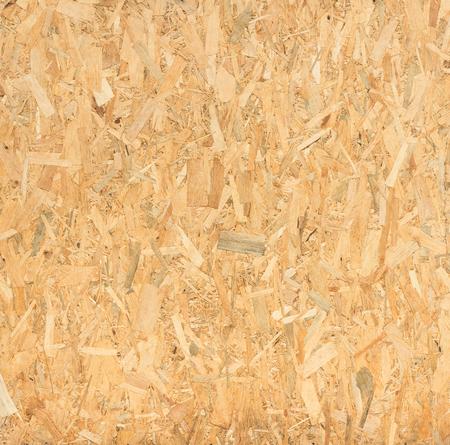 sluit omhoog geperst houten paneel achtergrond, naadloze textuur van oriented strand board - OSB hout