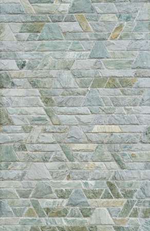 trapezoid: pattern color of modern style  design decorative  green slate stone wall surface with cement in trapezoid shape Stock Photo