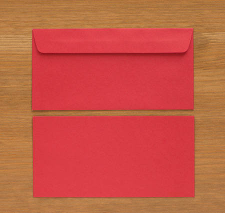 missive: close up red envelope on wood background Stock Photo