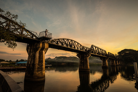 The death railway bridge is a history of world war ii, the death railway bridge over Kwai river built by Japanese soldiers at sunrise time, Kanchanaburi, Thailand