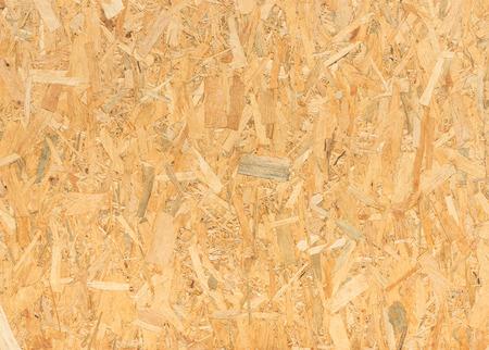 木製パネルの背景、配向性ストランド ボード - OSB 材のシームレス テクスチャを押されたクローズ アップ