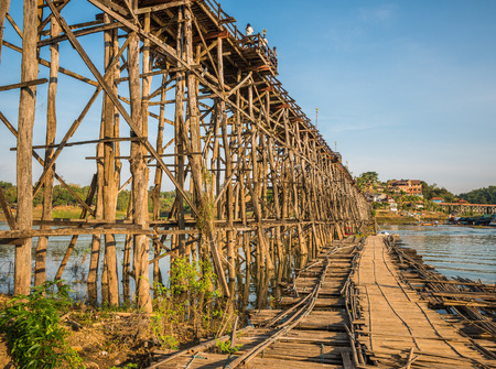 Wooded bridge over the river (Mon Bridge) in Sangkhlaburi District, Kanchanaburi, Thailand. And is a major tourist attraction of Thailand