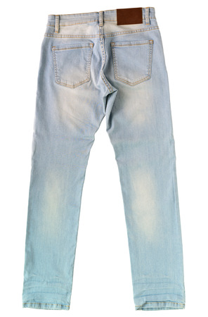 trouser legs: close up light blue jeans on floor background