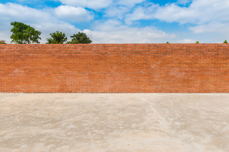 concrete surface finishing: background and texture of decorative red brick wall fence  on concrete floor with  tree and blue sky