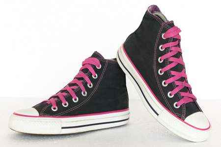 close up vintage style of sport black and pink sneaker shoes on white background