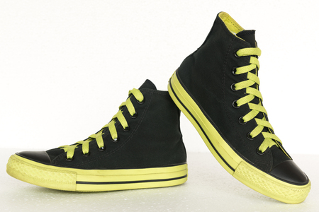 clothe: close up vintage style of sport black and green sneaker shoes on white background
