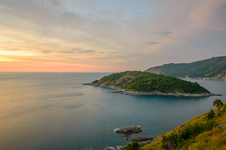 Promthep Cape is a mountain of rock that extends into the sea view point sunset at Phuket, Thailand