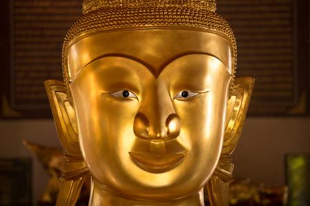 close up Phra phud in Wat Phra Thong Temple at Phuket, Thailand Stock Photo