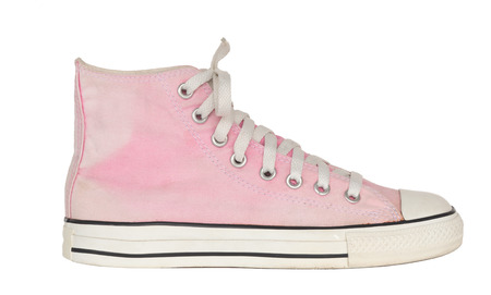 close up vintage style of sport pink sneaker shoe on white background