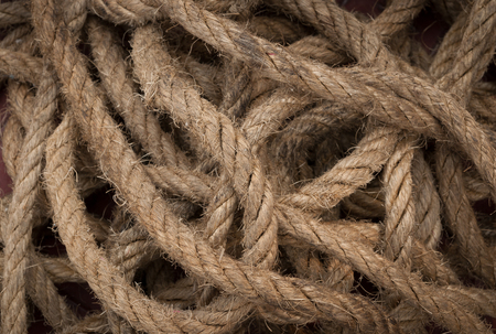 background and texture of old rope tied strip
