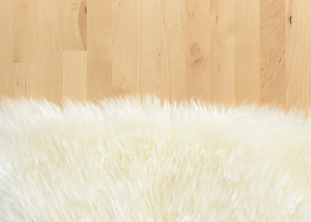 textured of real white cream wool sheep on Birch wood background