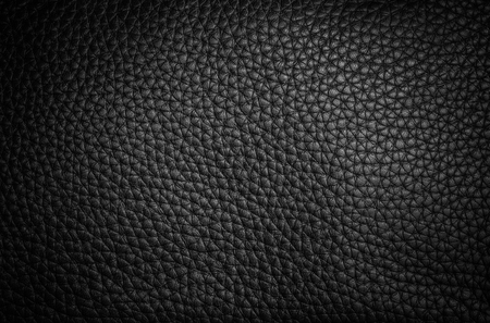 background and texture of real black leather sheet on bag leather