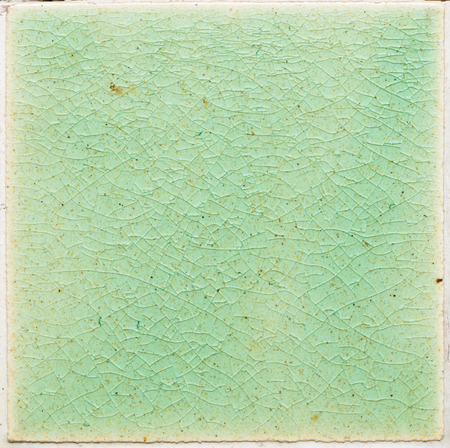 close up background and texture of stretch marks cracked on emerald green glazed tile Banco de Imagens