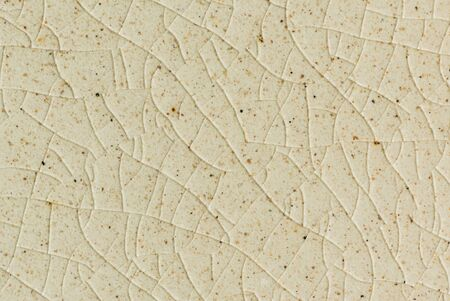 close up background and texture of stretch marks cracked on white cream glazed tile