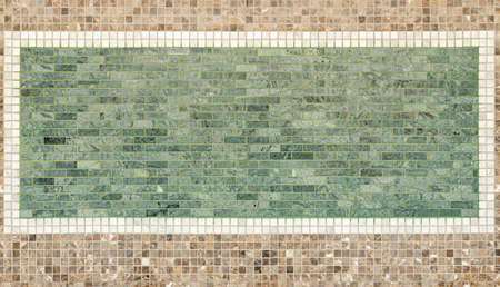 background and texture of green and brown mosaic tile on decorative wall. interior design of mosaic background on decorative wall.
