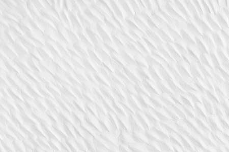 background and texture of  decorative concrete curve surface on house wall white color