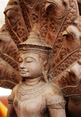 Carved wooden idol. Stock Photo