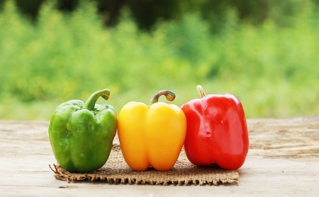 yellow and red and green pepper on white.