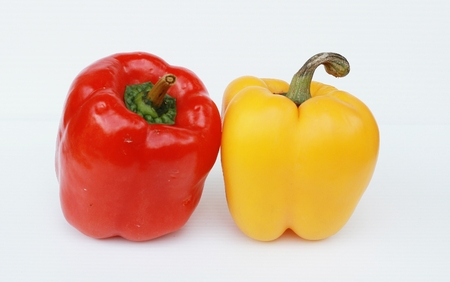 yellow and red pepper on white. Stock Photo