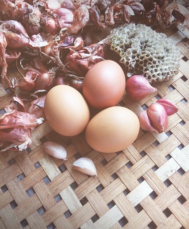 Eggs and onions in a basket, blur vintage. Stock Photo