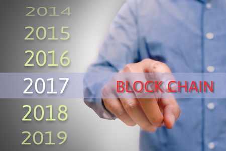 Man hand pointing block chain text, Body man, businessman planing for 2017. Business new year plans and targets concept. Banque d'images