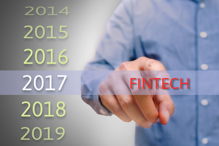 bussinessman: bussinessman hand pointing fintech text for 2017. targets  concept