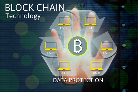 Block chain network concept and bitcoin icons, double exposure of hand showing word diagram as concept.