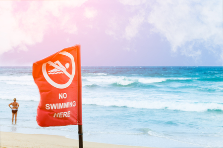 no swimming sign: No swimming danger sign at the beach, warning sign at the beach with people swim, caution no swimming allowed.
