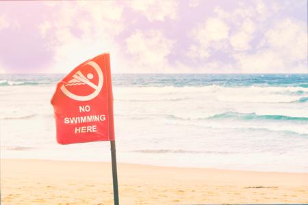 no swimming sign: No swimming danger sign at the beach, warning sign at the beach with people swim, caution no swimming allowed.