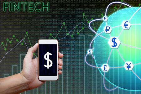 Tecnología financiera (Fintech) concepto. Hombre que sostiene teléfono inteligente y gráficos, análisis gráfico de la moneda con la red global y el fondo binario. Foto de archivo - 66367233