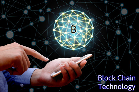 Blockchain technology concept, Businessman holding smartphone and virtual system diagram bitcoin and network background.