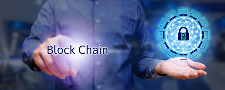 Blockchain technology concept, Businessman holding virtual system diagram bitcoin protection and pressing text.
