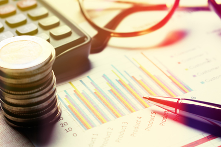 Finance savings concept, summary report chart with device financial. Stock Photo