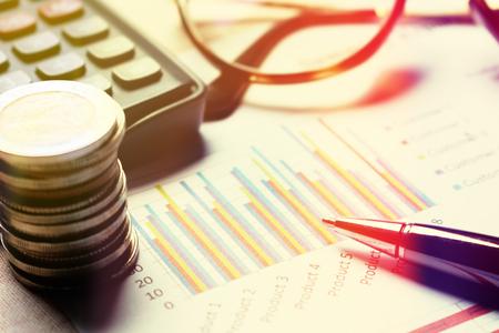 Finance savings concept, summary report chart with device financial. 版權商用圖片