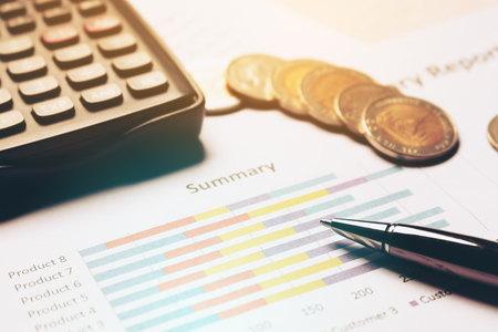 Finance savings concept, business equipment on paperwork. 版權商用圖片