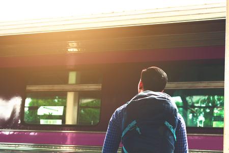 Asain man standing on platform waiting train. Stock Photo
