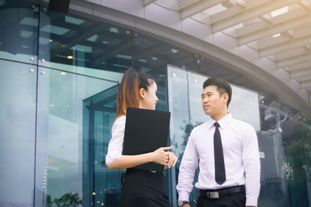 Asian business couple talking about future about working.