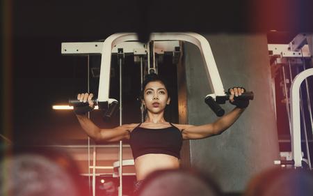 Asian sporty woman exercise gym club.