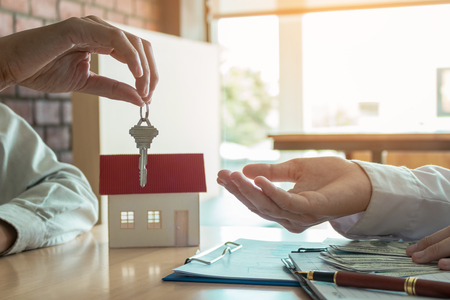 Salesman home brokers provide key to new homeowners.